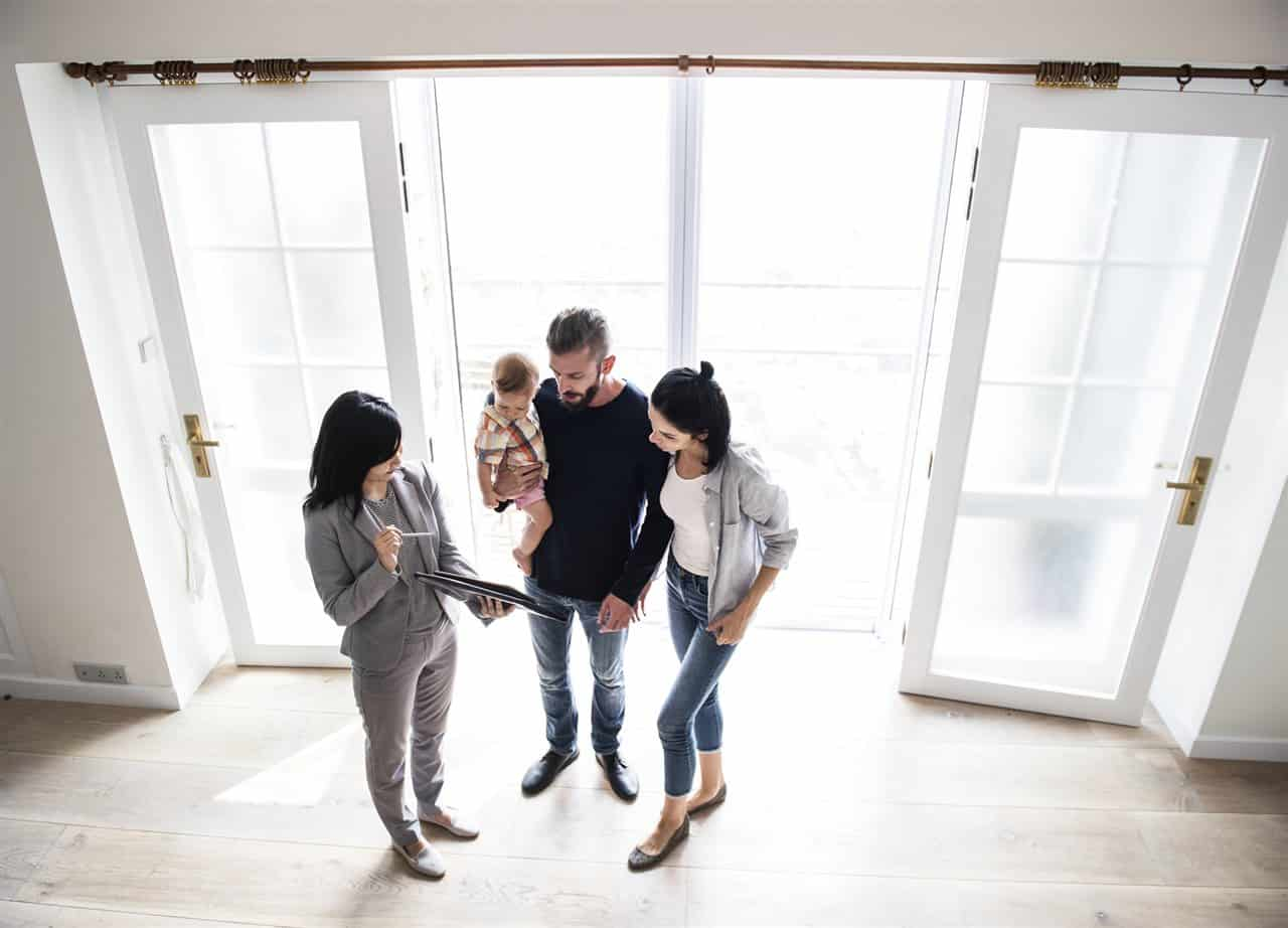 the home agent and family in the house | Prestige Home Inspections | Mortgage insurance Akron
