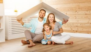 family under cardboard roof | Prestige Home Inspections | New roofing Akron