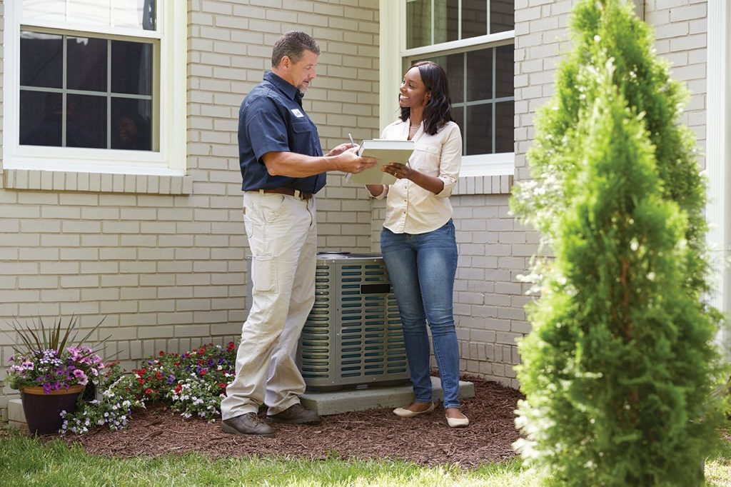 Inspector and homeowner | Prestige Home Inspections | Home warranty plans Akron